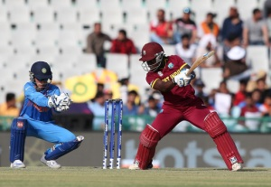 Deandra Dottin of the West Indies hits out with Sushma Verma of India looking on during the Women's ICC World Twenty20 India 2016 Photo credit ICC/Getty Images
