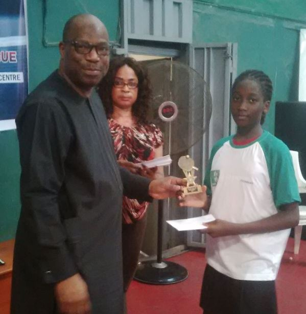 NTTF President, Wahid Oshodi with winner of the day in the girls event, Sukurat Aiyelabegan at the U-16 league in Lagos