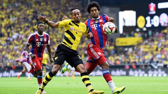 Pierre-Emerick Aubameyang of Dortmund and Dante of Munich compete for the ball photo credit ar.fifa.com