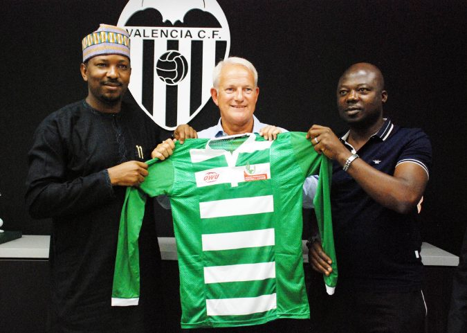 Chairman of LMC, Shehu Dikko and Chairman of Club Owners and Managers, Barrister Isaac Danladi presenting an NPFL All-Star jersey to Peter Draper, Commercial and Marketing Director of Valencia CF