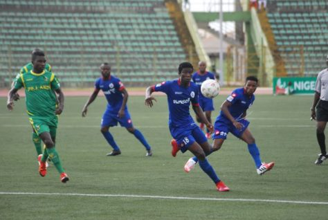 Rivers United's Wilson Andoh (L)