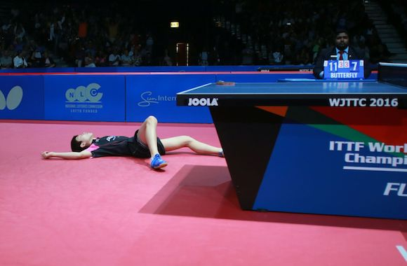 Harimoto falls to the ground after becoming the youngest ever World Junior Champion!