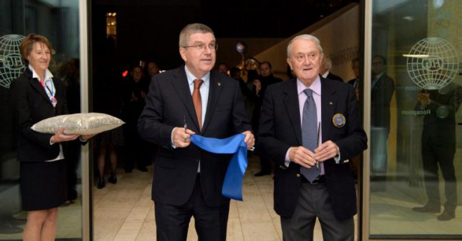 IOC President Thomas Bach and FIG President Bruno Grandi after cutting the ribbon