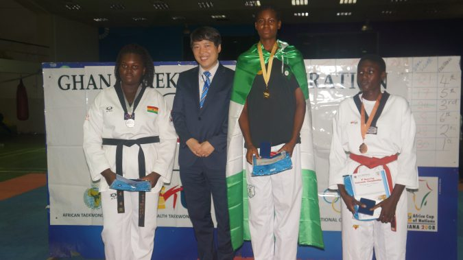 17-year old Elizabeth Anyanacho recieves her Gold medal at the 8th Korea Open Taekwondo Championships