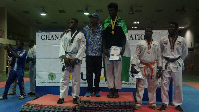 19-year old Peper Itiku recieves his Gold medal at the 8th Korea Open Taekwondo Championships