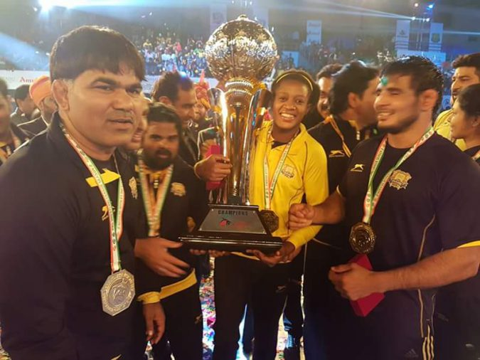 Nigeria's Adekuoroye With Punjab's  Wrestling League Trophy credit: Pro Wrestling League