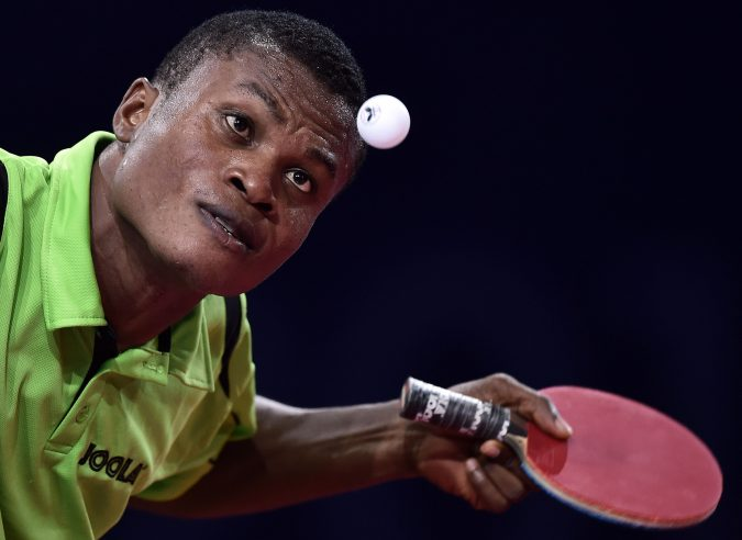 Nigeria's Ojo Onaolapo serves the ball to India's Kamal Sharath Achanta (unseen) during their Bronze Medal Team table tennis match at the 2014 Commonwealth Games in Glasgow on July 28, 2014.  AFP PHOTO / ANDREJ ISAKOVIC