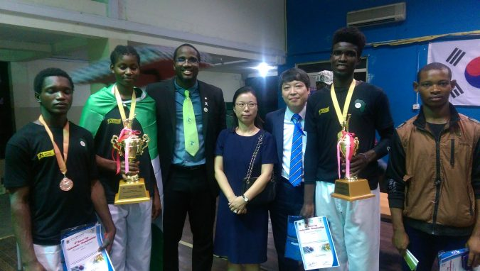 Trophy-laden Team CCSF takes a picture with representatives of the Korean Embassy in Ghana at the 8th Korea Open Taekwondo Championships.