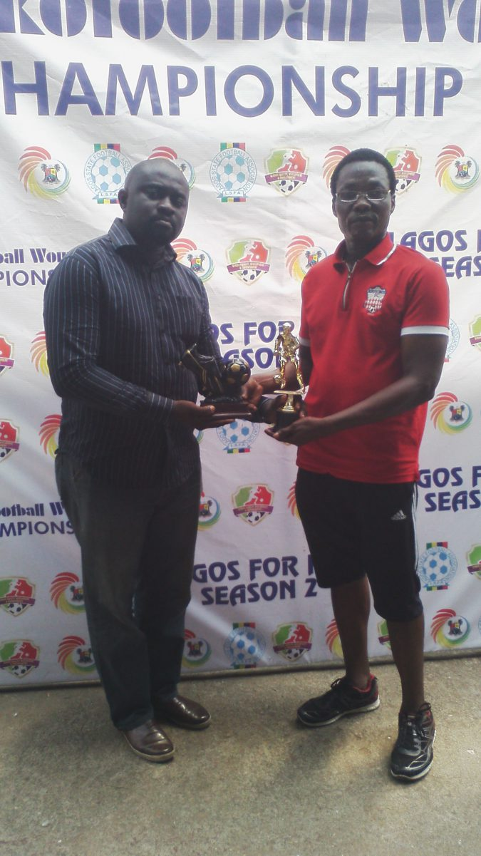 GM Freestan football club, Kingsley Utuedor presenting trophies donated to Lagos State Football Association Board Member and Chairman  Ekofootball Women Championship Organising Committee Mr Wale Joseph
