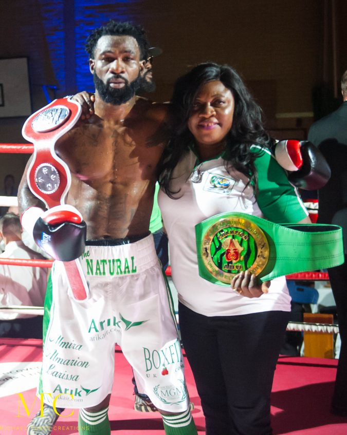 Undefeated welterweight sensation Larry Ekundayo with Chair of the House of Representative Committee on the Diaspora, Hon. (Barr) Rita Orji,